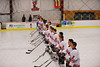 Baldwinsville Bees players and coaches stand for the national anthem before a game against the Cicero-North Syracuse Northstars at the Greater Baldwinsville Ice Arena on Thursday, December 1, 2011.  Baldwinsville won 10-5.