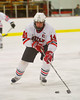 Baldwinsville Bees captain Steve Schneid (14) with the puck against the Hamilton Emerald Knights in Section III Boys Ice Hockey at the Greater Baldwinsville Ice Arena on Tuesday, January 3, 2012.  Baldwinsville won 4-2.