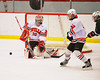 Baldwinsville Bees goaltender Chris Johns (30) gets into postion to make a save against the Hamilton Emerald Knights in Section III Boys Ice Hockey at the Greater Baldwinsville Ice Arena on Tuesday, January 3, 2012.  Baldwinsville won 4-2.