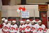 Baldwinsville Bees line up under a Happy Birthday poster to Dan Strodel (24) before playing the Hamilton Emerald Knights in Section III Boys Ice Hockey at the Greater Baldwinsville Ice Arena on Tuesday, January 3, 2012.  Baldwinsville won 4-2.