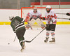 \Hamilton Emerald Knights Zach Sampson (23) fires a shot on the Baldwinsville Bees net in Section III Boys Ice Hockey at the Greater Baldwinsville Ice Arena on Tuesday, January 3, 2012.  Baldwinsville won 4-2.
