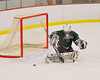 Hamilton Emerald Knights goalie Brady Carroll (31) kicks out the puck in a game against the Baldwinsville Bees in Section III Boys Ice Hockey at the Greater Baldwinsville Ice Arena on Tuesday, January 3, 2012.  Baldwinsville won 4-2.