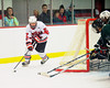 Baldwinsville Bees forward Brian Burlingame (27) looking to make a play from behind the Hamilton Emerald Knights net in Section III Boys Ice Hockey at the Greater Baldwinsville Ice Arena on Tuesday, January 3, 2012.  Baldwinsville won 4-2.