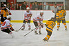 McQuaid Knights Albino DiAngelo (10) shot is blocked by Baldwinsville Bees Dan Strodel (24) at the Greater Baldwinsville Ice Arena in Baldwinsville, New York. McQuaid won 4-3 in overtime.