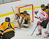 McQuaid Knights goalie Brian Burns (30) corals the puck while Baldwinsville Bees Steve Schneid (14) looks for a rebound at the Greater Baldwinsville Ice Arena in Baldwinsville, New York. McQuaid won 4-3 in overtime.