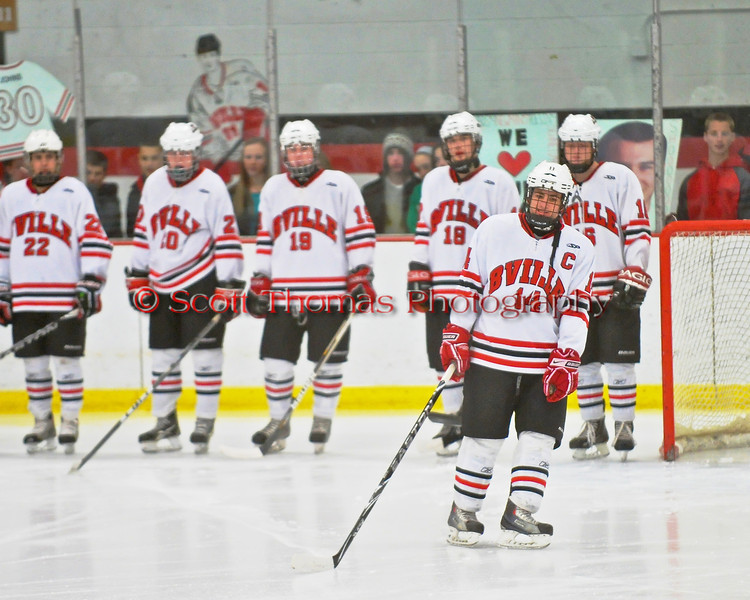 Baldwinsville Bees senior captain Steve Schneid (14) is introduced before the game against the McQuaid Knights at the Greater Baldwinsville Ice Arena in Baldwinsville, New York. McQuaid won 4-3 in overtime.