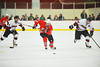 Baldwinsville Bees Mike Schneid (20) racing up ice with Syracuse Cougars Ben Walsh (27) and Ryan Lehrer (8) in pursuit at Meachem Ice Rink in Syracuse, New York.  Baldwinsville won 4-3.