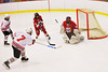 Baldwinsville Bees Parker Ferrigan (7) has his shot blocked by Central Square Redhawks goalie Mike Brown (30) in a Section III Playoff game at the Greater Baldwinsville Ice Arena in Baldwinsville, New York on Thursday, February 14, 2013.  Baldwinsville won 8-2.