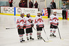 Baldwinsville Bees Parker Ferrigan (7), Garrett Gray (18), Matt Zandri (22) and Garth Gray during the starting lineup introductions before playing the Central Square Redhawks at the Greater Baldwinsville Ice Arena in Baldwinsville, New York.  Baldwinsville won 3-1.