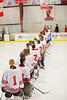 Baldwinsville Bees stand along the blue line during the National Anthem before playing the Central Square Redhawks at the Greater Baldwinsville Ice Arena in Baldwinsville, New York.  Baldwinsville won 3-1.