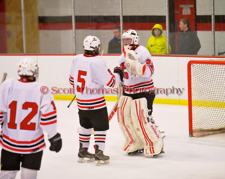 Baldwinsville Bees Matthew Colclough (5) and goalie Josh Pinard (39) celebrate a win over the Cortland-Homer Golden Eagles at the Greater Baldwinsville Ice Arena in Baldwinsville, New York.  Baldwinsville won 5-1.