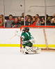 Fayetteville-Manlius Hornets goalie Erik Badger (33) watches the puck after making a save on a shot by a Baldwinsville Bees player at the Greater Baldwinsville Ice Arena in Baldwinsville, New York.  Baldwinsville won 4-2.