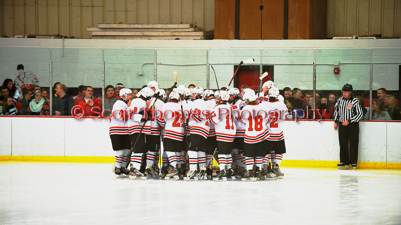 Baldwinsville Bees huddle up before the game against the Fayetteville-Manlius Hornets at the Greater Baldwinsville Ice Arena in Baldwinsville, New York.  Baldwinsville won 4-2.