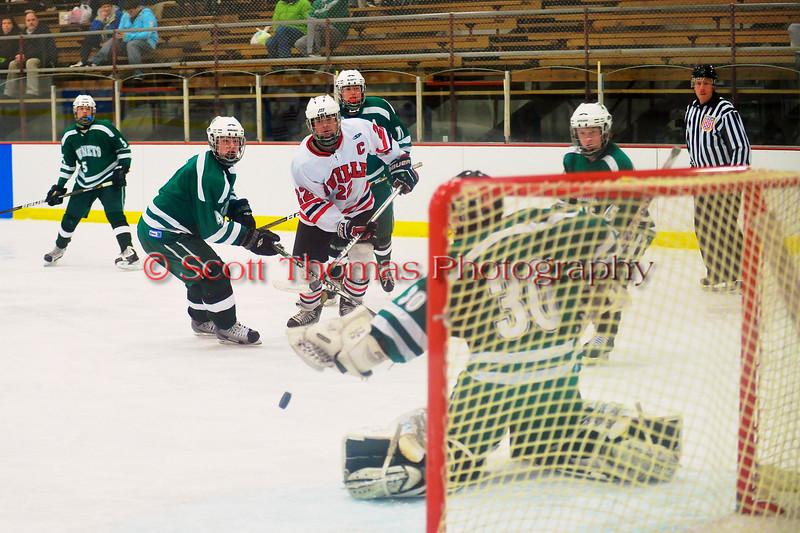 Baldwinsville Bees Matt Zandri (22) shoots the puck wide against the Fayetteville-Manlius Hornets at the Greater Baldwinsville Ice Arena in Baldwinsville, New York.  Baldwinsville won 4-2.