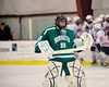 Fayetteville-Manlius Hornets goalie Erik Badger (33) heads back to his net after a timeout in a game against the Baldwinsville Bees at the Greater Baldwinsville Ice Arena in Baldwinsville, New York.  Baldwinsville won 4-2.