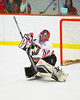 Baldwinsville Bees goalie Nick Harper (31) making a save in warm ups before the game with the Fayetteville-Manlius Hornets at the Greater Baldwinsville Ice Arena in Baldwinsville, New York.  Baldwinsville won 4-2.