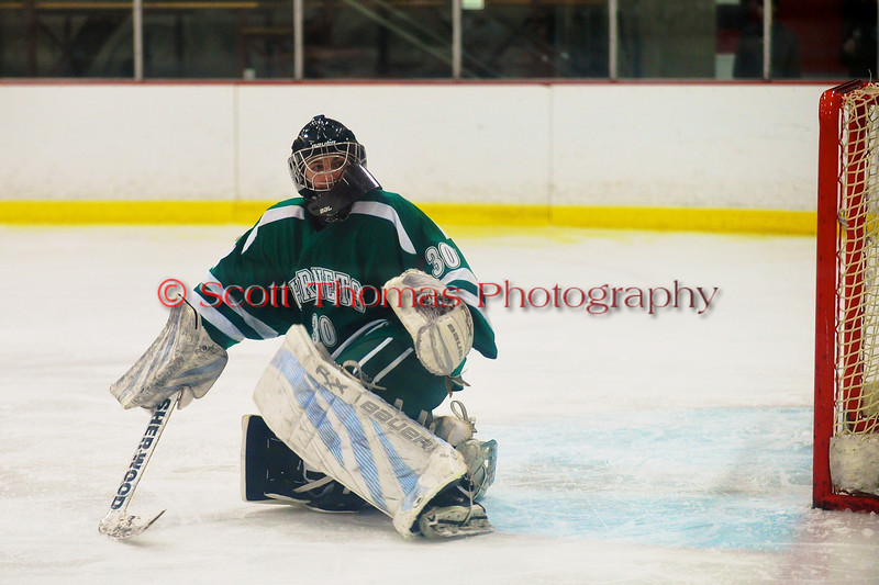 Fayetteville-Manlius Hornets goalie Ben Napierala (30) checks out the location of the puck after a shot by a Baldwinsville Bees player at the Greater Baldwinsville Ice Arena in Baldwinsville, New York.  Baldwinsville won 4-2.