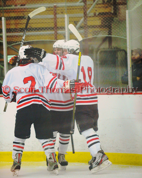 Baldwinsville Bees players celebrate a goal by Parker Ferrigan (7) against the Fayetteville-Manlius Hornets at the Greater Baldwinsville Ice Arena in Baldwinsville, New York.  Baldwinsville won 4-2.