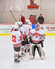 Baldwinsville Bees starting lineup greet goalie Nick Harper (31) before playing the West Genesee Wildcats at the Greater Baldwinsville Ice Arena in Baldwinsville, New York.  West Genesee won 3-0.