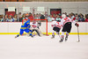 Baldwinsville Bees goalie Nick Harper (31) gets ready to stop a West Genesee Wildcats player  at the Greater Baldwinsville Ice Arena in Baldwinsville, New York.  West Genesee won 3-0.
