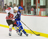 Baldwinsville Bees Matt Abbott (29)  checks Watertown IHC Cavaliers defencemen Jared Pignone (6) at the Greater Baldwinsville Ice Arena in Baldwinsville, New York.  Baldwinsville won 6-0.