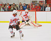 Baldwinsville Bees goalie Matt Abbott (29) makes a blocker save against the Watertown IHC Cavaliers at the Greater Baldwinsville Ice Arena in Baldwinsville, New York.  Baldwinsville won 6-0.