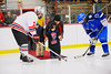 Baldwinsville Bees captain Parker Ferrigan (7) takes a ceremonial face-off from a young fan before the game against the Watertown IHC Cavaliers at the Greater Baldwinsville Ice Arena in Baldwinsville, New York.  Baldwinsville won 6-0.
