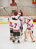 Baldwinsville Bees starting lineup greets goalie Josh Pinard (39) before playing the Watertown IHC Cavaliers at the Greater Baldwinsville Ice Arena in Baldwinsville, New York.  Baldwinsville won 6-0.