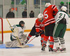 Baldwinsville Bees Luke McCaffrey (2) tries to get a rebound past Fayetteville-Manlius Hornets goalie Ben Napierala (30) at Cicero Twin Rinks in Cicero, New York on Friday, February 7, 2014.  Baldwinsville won 2-1 in Overtime. © Scott Thomas Photography