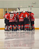 Baldwinsville Bees huddle up before the start of the third period against the Fayetteville-Manlius Hornets at Cicero Twin Rinks in Cicero, New York on Friday, February 7, 2014.  Baldwinsville won 2-1 in Overtime. © Scott Thomas Photography