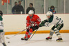Baldwinsville Bees James Pelcher (17) skates past Fayetteville-Manlius Hornets defender Tyler Tracy (15) at Cicero Twin Rinks in Cicero, New York on Friday, February 7, 2014.  Baldwinsville won 2-1 in Overtime. © Scott Thomas Photography