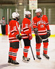 Baldwinsville Bees players Dave Mazurkiewicz (10), Adam Tretowicz (21) and Charlie Bertrand (15) during player introductions before a game against the Fulton Red Raiders at the Fulton Community Ice Arena in Fulton, New York on Friday, January 10, 2014.  Baldwinsville won 4-1.