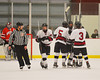 Syracuse Cougars players celebrate the tying goal by Matt Eccles (5) against the Baldwinsville Bees at the Meachem Ice Rink in Syracuse, New York on Thursday, February 13, 2014.  Syracuse won in triple overtime 2-1. © Scott Thomas Photography