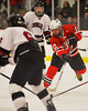 Baldwinsville Bees Sean Barron (12) plays the puck against the Syracuse Cougars at the Meachem Ice Rink in Syracuse, New York on Thursday, February 13, 2014.  Syracuse won in triple overtime 2-1. © Scott Thomas Photography