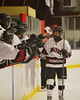 Syracuse Cougars Matt Eccles (5) celebrates his goal against the Baldwinsville Bees with this teammates at the Meachem Ice Rink in Syracuse, New York on Thursday, February 13, 2014.  Syracuse won in triple overtime 2-1. © Scott Thomas Photography