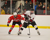 Baldwinsville Bees James Pelcher (17) defends against Syracuse Cougars Sean Eccles (3) at the Meachem Ice Rink in Syracuse, New York on Thursday, February 13, 2014.  Syracuse won in triple overtime 2-1. © Scott Thomas Photography