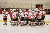 Baldwinsville Bees huddle up before playing the Ithaca Little Red at the Greater Baldwinsville Ice Arena in Baldwinsville, New York on Tuesday, December 10, 2013.  Teams skated to a 5-5 tie.