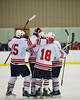 Baldwinsville Bees players celebrate a goal by Charlie Bertrand (15) against the Ithaca Little Red at the Greater Baldwinsville Ice Arena in Baldwinsville, New York on Tuesday, December 10, 2013.  Teams skated to a 5-5 tie.