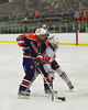 Baldwinsville Bees Carson Hayes (16) battles for position with a Liverpool Warriors player at the Greater Baldwinsville Ice Arena in Baldwinsville, New York on Tuesday, January 21, 2014.  Liverpool won 3-1.