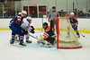 Liverpool Warriors goalie Steven Kozikoski (1) keeps the puck out of his net from a shot by Baldwinsville Bees Matt Monaco (22) at the Greater Baldwinsville Ice Arena in Baldwinsville, New York on Tuesday, January 21, 2014.  Liverpool won 3-1.