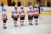 Baldwinsville Bees players Dave Mazurkiewicz (10), Matt Monaco (22), Mike Schneid (20), Matt Abbott (29) and Tyler Church (23) during pre-game introductions before playing the Rome Free Academy Black Knights at the Greater Baldwinsville Ice Arena in Baldwinsville, New York on Tuesday, January 28, 2014.  RFA won 4-2.