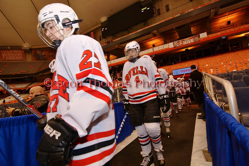 Baldwinsville Bees players Matt Metcalf (27) and Ben Dwyer (4) walk out to play the Cicero-North Syracuse Northstars at the Carrier Dome in Syracuse, New York on Friday, November 21, 2014. Cicero-North Syracuse won 3-2 in overtime.