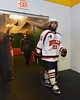 Baldwinsville Bees Adam Tretowicz (21) heads to the ice before playing the Ithaca Little Red in a NYSPHSAA Ice Hockey Championship Regional Playoff game at The Rink in Ithaca, New York on Saturday, March 7, 2015.  Baldwinsville won 2-1..