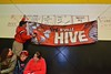 "Baldwinsville Bees ""The Hive"" banner being hung before the Bees played the Ithaca Little Red in a NYSPHSAA Ice Hockey Championship Regional Playoff game at The Rink in Ithaca, New York on Saturday, March 7, 2015.  Baldwinsville won 2-1.."
