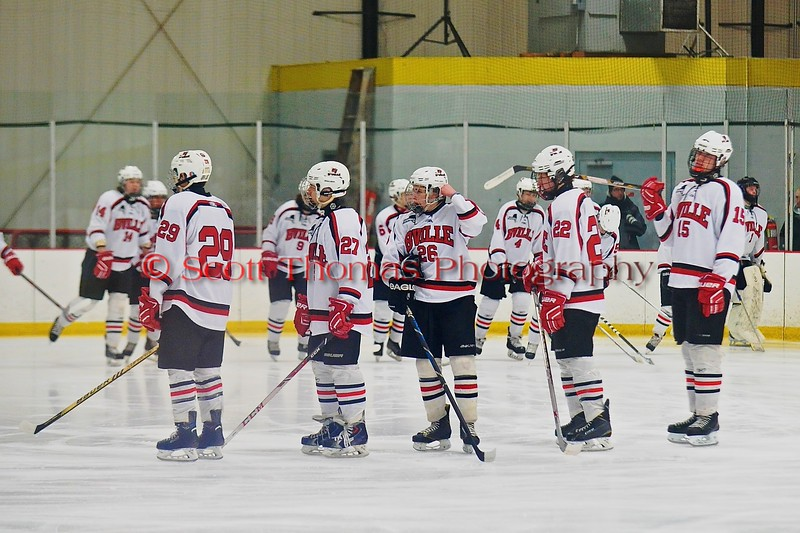 Baldwinsville Bees staring lineup of Matt Abbott (29), Matt Metcalf (27), Kyle Lindsay (26), Matt Monaco (22) and Charlie Bertrand (15) introduced before playing the Ithaca Little Red in a NYSPHSAA Ice Hockey Championship Regional Playoff game at The Rink in Ithaca, New York on Saturday, March 7, 2015.  Baldwinsville won 2-1..