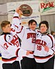 Baldwinsville Bees captains James Pelcher (17), Matt Abbott (29) and Kyle Lindsay (26) hold the NYSPHSAA Ice Hockey Championship Regional trophy after defeating the Ithaca Little Red, 2-1, at The Rink in Ithaca, New York on Saturday, March 7, 2015.
