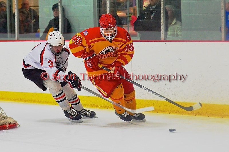 Baldwinsville Bees Alex Paterson-Jones (3) chases Ithaca Little Red Ben Rogers (13) in a NYSPHSAA Ice Hockey Championship Regional Playoff game at The Rink in Ithaca, New York on Saturday, March 7, 2015.  Baldwinsville won 2-1..