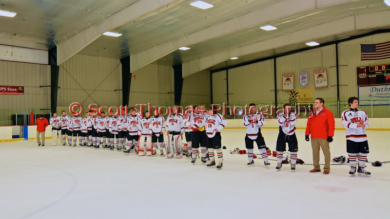 Baldwinsville Bees after a NYSPHSAA Ice Hockey Championship Regional Playoff game at The Rink in Ithaca, New York on Saturday, March 7, 2015.