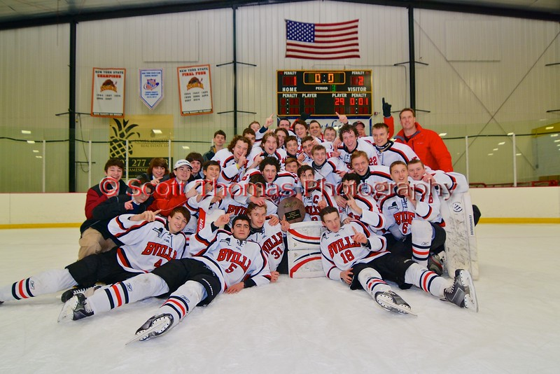 Baldwinsville Bees celebrate their 2-1 victory over the Ithaca Little Red in the NYSPHSAA Ice Hockey Championship Regional Playoff game at The Rink in Ithaca, New York on Saturday, March 7, 2015.