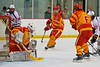 Ithaca Little Red goalie Griffin Varrichio (29) makes a pad save against the Baldwinsville Bees in a NYSPHSAA Ice Hockey Championship Regional Playoff game at The Rink in Ithaca, New York on Saturday, March 7, 2015.  Baldwinsville won 2-1..